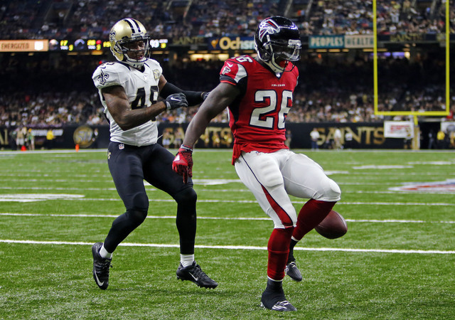 Atlanta Falcons running back Tevin Coleman (26) crosses into the end zone for a touchdown in front of New Orleans Saints free safety Vonn Bell (48) in the second half of an NFL football game in Ne ...