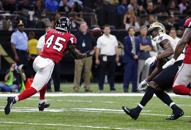 Atlanta Falcons outside linebacker Deion Jones (45) intercepts a pass from New Orleans Saints quarterback Drew Brees, not pictured, and returns it for a touchdown, in the second half of an NFL foo ...