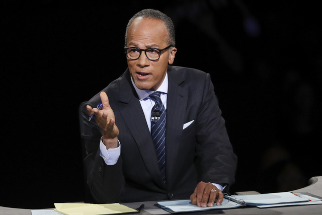 Moderator Lester Holt, anchor of NBC Nightly News, asks a question of Democratic presidential nominee Hillary Clinton during the presidential debate with Republican presidential nominee Donald Tru ...