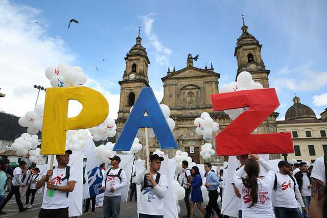 """People hold up letters that form the word """"Peace"""" in Spanish during a gathering at Bolivar square in Bogota, Colombia, Monday, Sept. 26, 2016. Colombia's government and the Revolutionary Armed For ..."""
