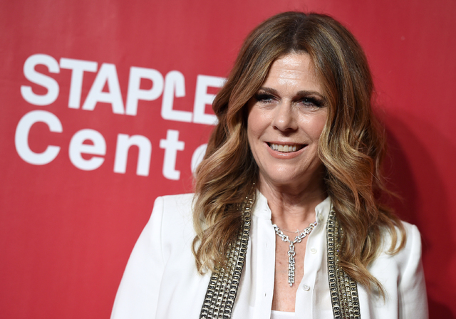 In this Feb. 13, 2016 file photo, Rita Wilson arrives at the MusiCares Person of the Year tribute honoring Lionel Richie at the Los Angeles Convention Center. The newest members of the film academ ...