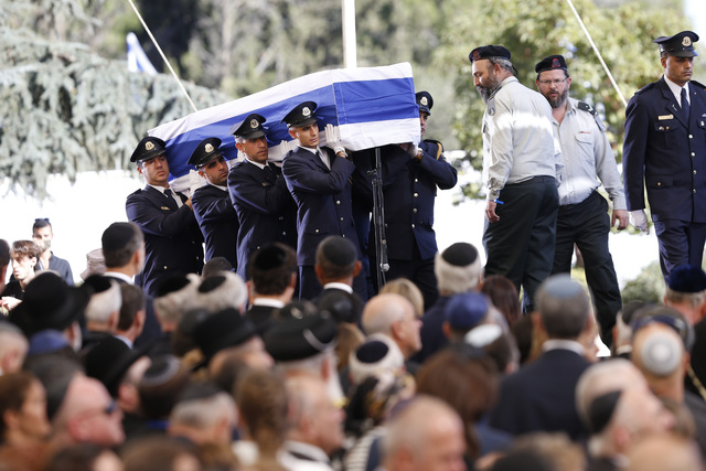 Knesset guards carry the flag-draped coffin during the funeral of former Israeli President Shimon Peres at the Mount Herzel national cemetery in Jerusalem on Friday. (Ariel Schalit/AP)