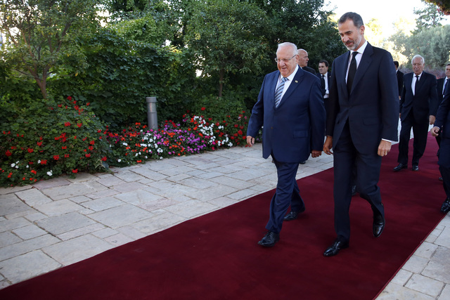 Israeli President President Reuven Rivlin, left, walks with the King of Spain Felipe IV upon the latter's arrival at the presidential compound in Jerusalem on Friday, Sept. 30, 2016. U.S. Presiden ...