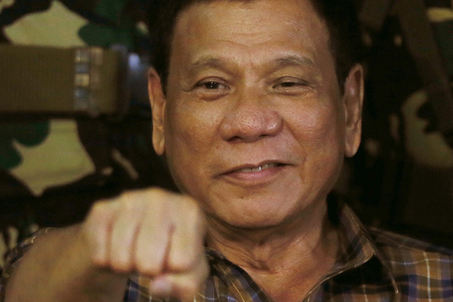 Since Philippine President Rodrigo Duterte was elected in May, more than 3,000 suspected drug dealers and users have been killed and nearly 700,000 others have surrendered. (Bullit Marquez/AP)