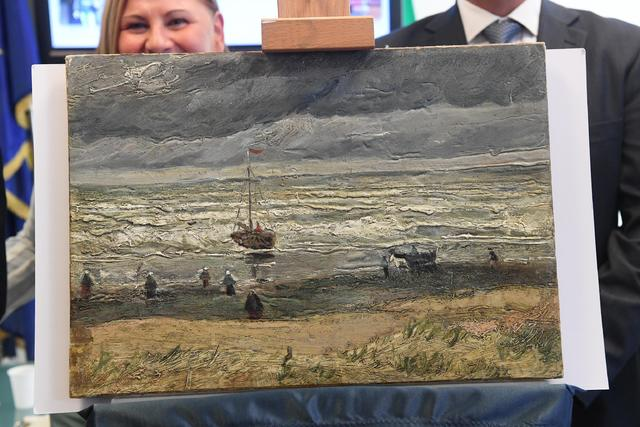 The recovered painting Seascape at Scheveningen by Vincent Van Gogh, is shown Friday during a news conference in Naples, Italy. This painting and another one, Congregation Leaving The Reformed Chu ...