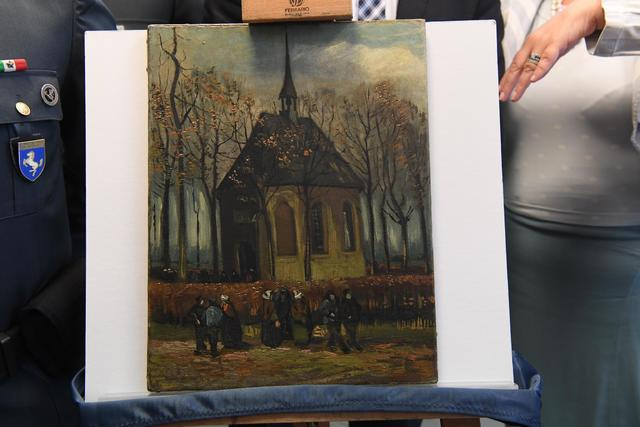 The painting Congregation Leaving The Reformed Church of Nuenen by Vincent Van Gogh, is shown Friday during a news conference in Naples, Italy. This painting and another one, Seascape at Schevenin ...