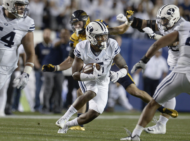 BYU defensive back Dayan Lake (5) turns to run after intercepting a Toledo pass during the first half of an NCAA college football game Friday, Sept. 30, 2016, in Provo, Utah. (Scott Sommerdorf/The ...