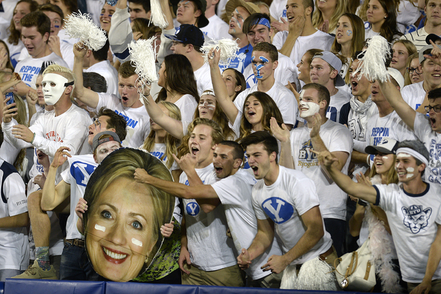 BYU fans celebrate, some holding a cutout of Hillary Clinton, during the team's NCAA college football game against Toledo on Friday, Sept. 30, 2016, in Provo, Utah. (Scott Sommerdorf/The Salt Lake ...