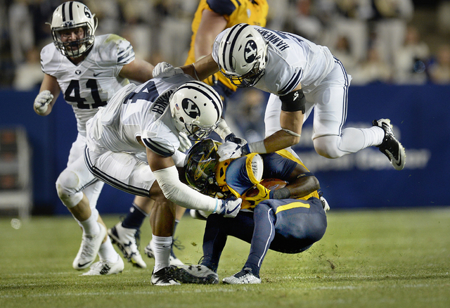 The BYU defense swarms over Toldeo running Kareem Hunt during the first half of an NCAA college football game Friday, Sept. 30, 2016, in Provo, Utah. (Scott Sommerdorf/The Salt Lake Tribune via AP)