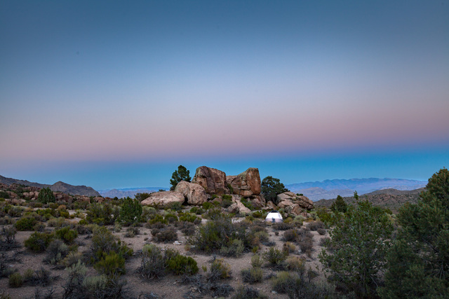 """A lone tent is dwarfed by the landscape at Basin and Range National Monument in this photo by Julian Kilker, part of the """"Home Means Nevada"""" exhibit now on display at the Senate Russell Building o ..."""