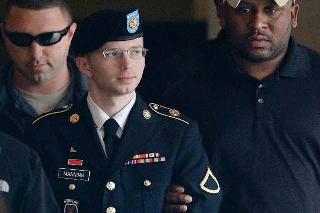 Army Pfc. Bradley Manning is escorted to a security vehicle Tuesday in Fort Meade, Md., after he was sentenced to 35 years in prison for sending classified material to WikiLeaks. (Patrick Semansky ...