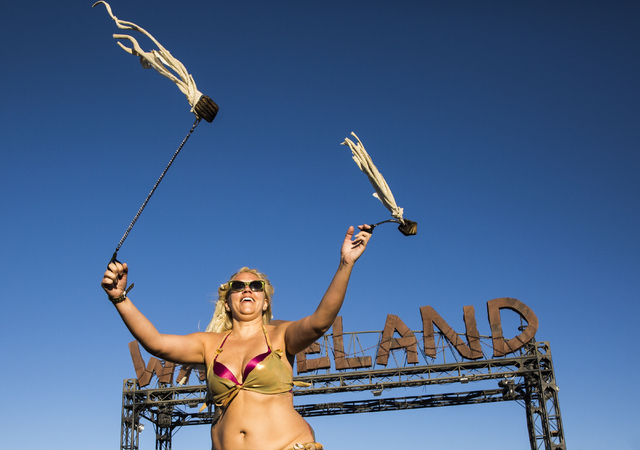 Goldie Vegas, a member of the Nuclear Bombshells, a post-apocalyptic burlesque group based in Las Vegas, performs during the seventh annual Wasteland Weekend on Friday, Sept. 23, 2016, in Californ ...