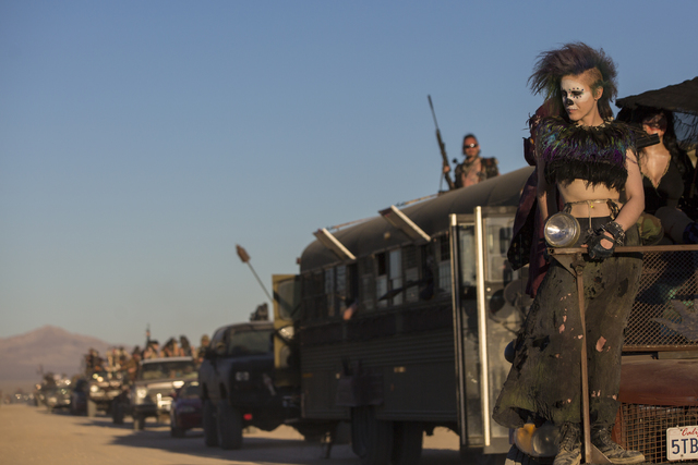 Alison Kelly, right, rides in a modified jeep during a vehicle cruise during the seventh annual Wasteland Weekend on Friday, Sept. 23, 2016, in California City, Calif. The four day, post-apocalypt ...