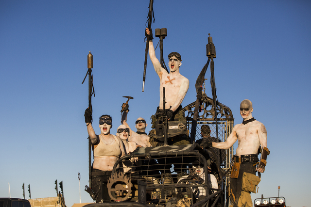War boys participate in a vehicle cruise during the seventh annual Wasteland Weekend on Friday, Sept. 23, 2016, in California City, Calif. The four day, post-apocalyptic festival takes place in th ...