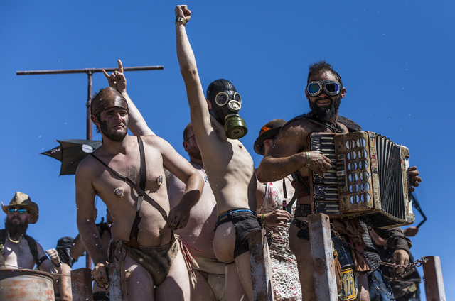 Contestants give one final group dance during the post-apocalyptic swimsuit contest during the seventh annual Wasteland Weekend on Saturday, Sept. 24, 2016, in California City, Calif. The four day ...