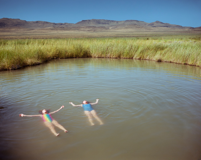 """Two girls float in a remote hot spring pool in a photograph by artist Peter Goin, who has two photos in the """"Home Means Nevada"""" exhibit now on display at the Senate Russell Building on Capitol Hil ..."""