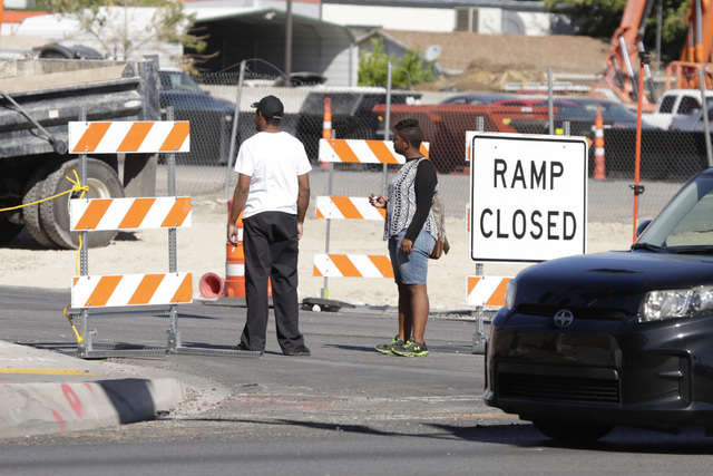 Pedestrians watch as workers start closing the Martin Luther King Boulevard onramp to northbound U.S. Highway 95 on Tuesday, Sept. 6, 2016. The onramp will be closed for the next two months beginn ...
