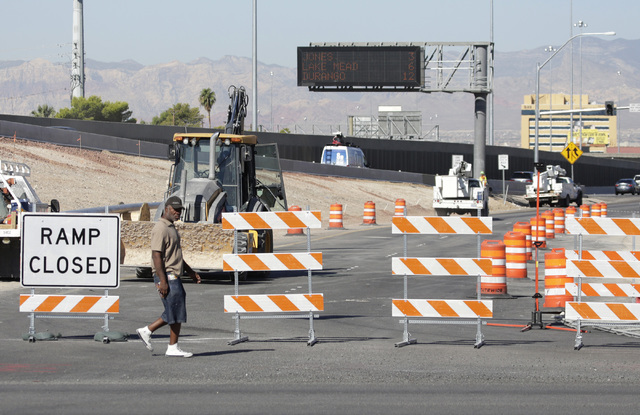 A pedestrian walks by the ramp closure sign on Tuesday, Sept. 6, 2016. The Martin Luther King Boulevard onramp to northbound U.S. Highway 95 will be closed for the next two months beginning Tuesda ...
