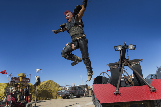 Steve Scholz leaps from his jeep during the seventh annual Wasteland Weekend on Friday, Sept. 23, 2016, in California City, Calif. The four day, post-apocalyptic festival takes place in the Mojave ...