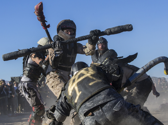 Competitors take part in a jugger match during the seventh annual Wasteland Weekend on Friday, Sept. 23, 2016, in California City, Calif. The four day, post-apocalyptic festival takes place in the ...