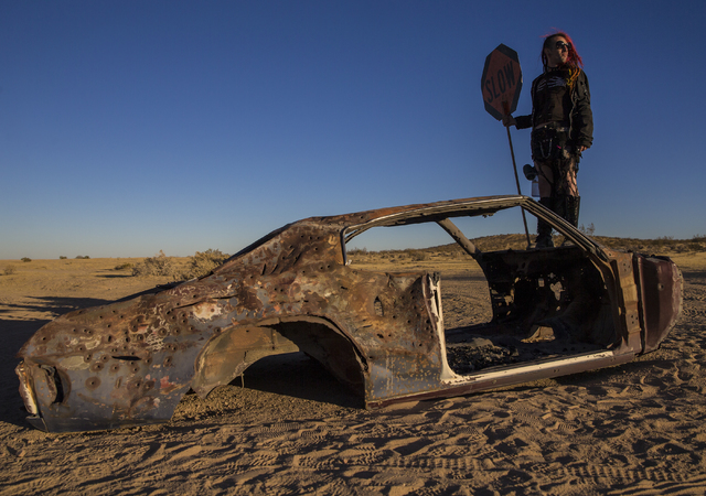Volunteer Nate Goedeck directs traffic during the seventh annual Wasteland Weekend on Friday, Sept. 23, 2016, in California City, Calif. The four day, post-apocalyptic festival takes place in the  ...