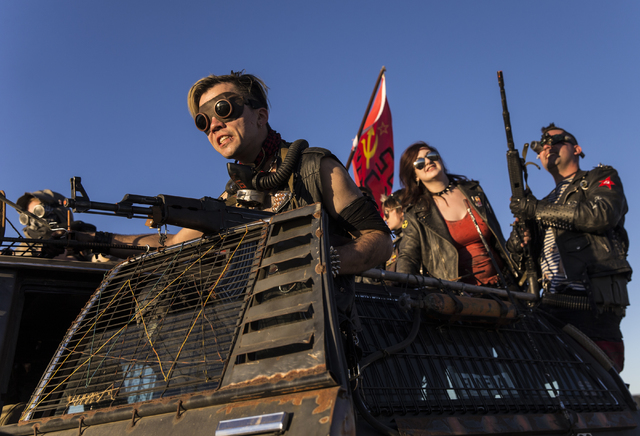 Participants in a vehicle cruise return to camp during the seventh annual Wasteland Weekend on Friday, Sept. 23, 2016, in California City, Calif. The four day, post-apocalyptic festival takes plac ...