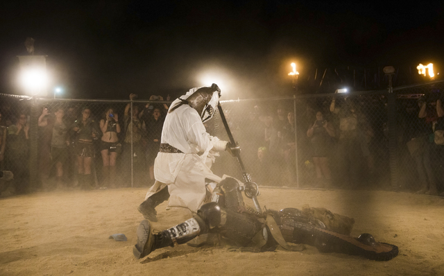 Wasteland gladiators battle during the seventh annual Wasteland Weekend on Friday, Sept. 23, 2016, in California City, Calif. The four day, post-apocalyptic festival takes place in the Mojave dese ...