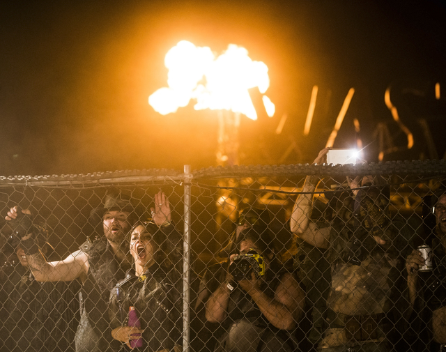 The crowd cheers as gladiators battle during the seventh annual Wasteland Weekend on Friday, Sept. 23, 2016, in California City, Calif. The four day, post-apocalyptic festival takes place in the M ...