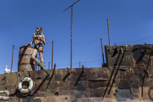 A water gunner waits for the start of the post-apocalyptic swimsuit contest during the seventh annual Wasteland Weekend on Saturday, Sept. 24, 2016, in California City, Calif. The four day, post-a ...