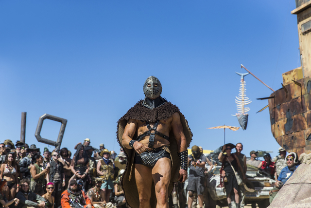 Humungus makes his entrance during the post-apocalyptic swimsuit contest during the seventh annual Wasteland Weekend on Saturday, Sept. 24, 2016, in California City, Calif. The four day, post-apoc ...