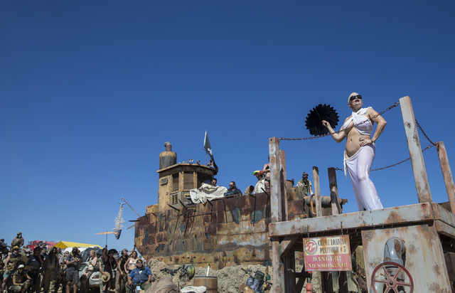 Dancers entertain the crowd before the start of the post-apocalyptic swimsuit contest during the seventh annual Wasteland Weekend on Saturday, Sept. 24, 2016, in California City, Calif. The four d ...