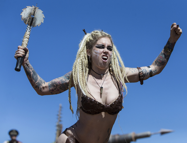 Contestants engage the crowd during the post-apocalyptic swimsuit contest during the seventh annual Wasteland Weekend on Saturday, Sept. 24, 2016, in California City, Calif. The four day, post-apo ...