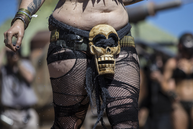 A contestant shows off her hand-made outfit during the post-apocalyptic swimsuit contest during the seventh annual Wasteland Weekend on Saturday, Sept. 24, 2016, in California City, Calif. The fou ...
