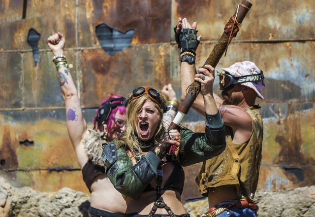 The crowd erupts at the conclusion of the post-apocalyptic swimsuit contest during the seventh annual Wasteland Weekend on Saturday, Sept. 24, 2016, in California City, Calif. The four day, post-a ...