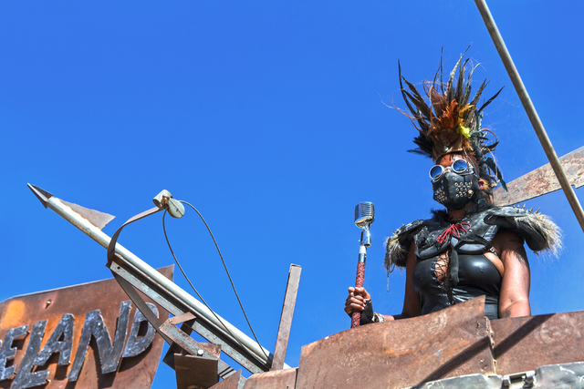 A gate guard watches over tent city during the seventh annual Wasteland Weekend on Saturday, Sept. 24, 2016, in California City, Calif. The four day, post-apocalyptic festival takes place in the M ...
