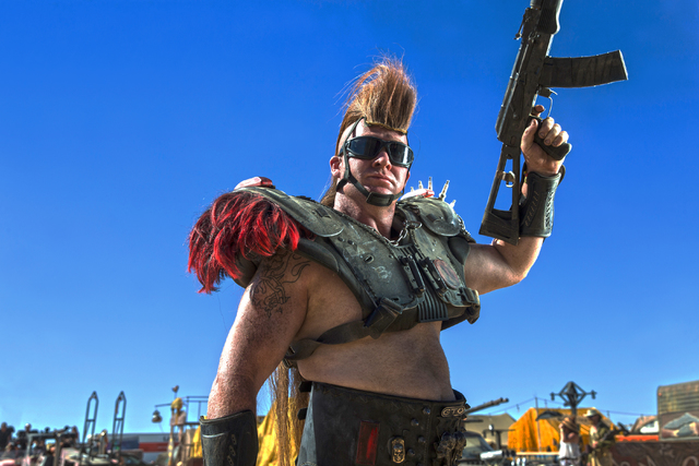 Jason Sperle, known as T-Wrex, poses for a photo during the seventh annual Wasteland Weekend on Saturday, Sept. 24, 2016, in California City, Calif. The four day, post-apocalyptic festival takes p ...