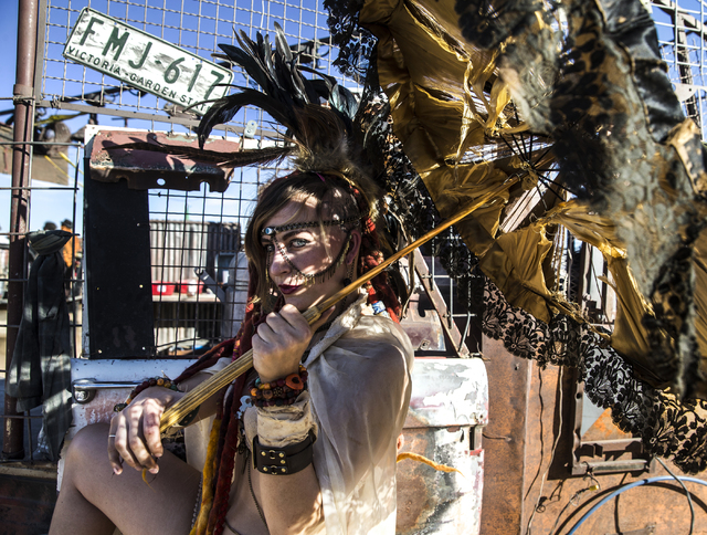 Keisha Mock poses for a photo during the seventh annual Wasteland Weekend on Saturday, Sept. 24, 2016, in California City, Calif. The four day, post-apocalyptic festival takes place in the Mojave  ...
