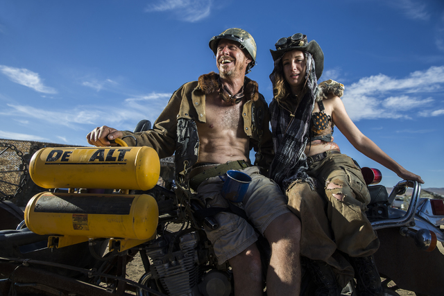 Spyder, left, and Wilee pose for a photo during the seventh annual Wasteland Weekend on Saturday, Sept. 24, 2016, in California City, Calif. The four day, post-apocalyptic festival takes place in  ...