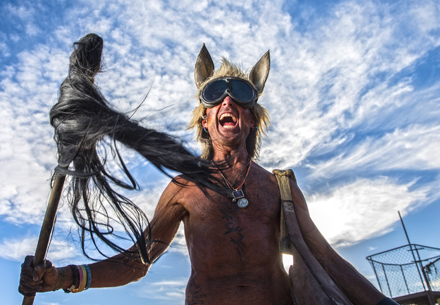 Keru McKenzie poses for a photo during the seventh annual Wasteland Weekend on Saturday, Sept. 24, 2016, in California City, Calif. The four day, post-apocalyptic festival takes place in the Mojav ...