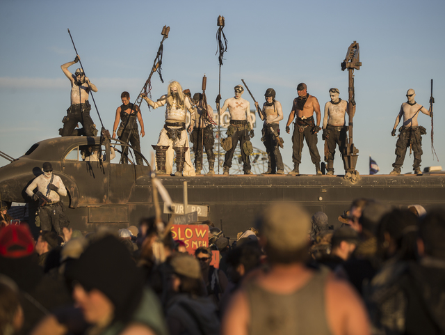 Festival goers gather at the city gates during the seventh annual Wasteland Weekend on Saturday, Sept. 24, 2016, in California City, Calif. The four day, post-apocalyptic festival takes place in t ...