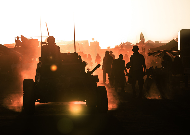 An armored dune buggy drives through the streets at dusk during the seventh annual Wasteland Weekend on Saturday, Sept. 24, 2016, in California City, Calif. The four day, post-apocalyptic festival ...