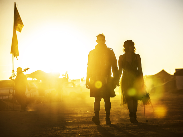 Will Gillaspy, left, and Sonia Soleno walk to a show during the seventh annual Wasteland Weekend on Saturday, Sept. 24, 2016, in California City, Calif. The four day, post-apocalyptic festival tak ...