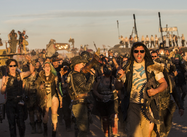 A large crowd of festival goers march through the camp ground during the seventh annual Wasteland Weekend on Saturday, Sept. 24, 2016, in California City, Calif. The four day, post-apocalyptic fes ...