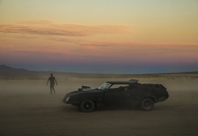 A replica of the car driven in the Mad Max films, a 1973 Ford Falcon XB GT Coupe, sits outside the gates of the seventh annual Wasteland Weekend on Saturday, Sept. 24, 2016, in California City, Ca ...