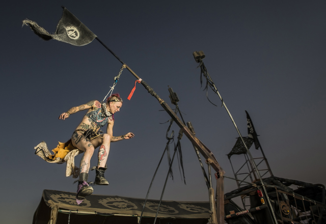 Maee Kroft swings from hooks attached to her skin, a practice known as suspension, during the seventh annual Wasteland Weekend on Saturday, Sept. 24, 2016, in California City, Calif. The four day, ...