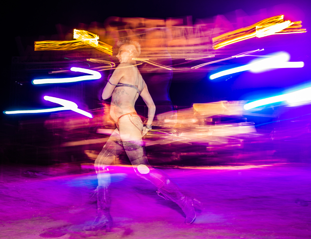 Nuclear Bombshell performer Mitzy Mayhem dances during the seventh annual Wasteland Weekend on Saturday, Sept. 24, 2016, in California City, Calif. The Nuclear Bombshells are a post-apocalyptic bu ...