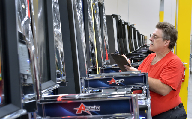 Quality assurance inspector Ron Corbin checks machines on the assembly line in the manufacturing area of the new North American headquarters for Ainsworth Game Technology at 5800 Rafael Rivera Way ...