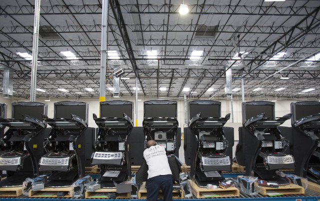 Ainsworth assembly worker James Nguyen works on a row of slot machines at the Ainsworth factory at 5800 Rafael Rivera Way in Las Vegas on Friday, Sept. 23, 2016. Richard Brian/Las Vegas Review-Jou ...
