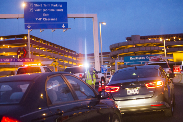 Law enforcement redirect traffic after two people were shot in a domestic incident in the parking garage at McCarran International Airport on Monday, Sept. 19, 2016, in Las Vegas. (Benjamin Hager/ ...