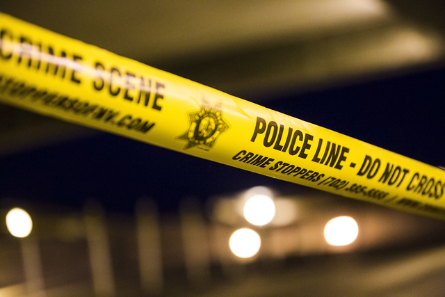 Las Vegas Metro taped off most of the top floor of the parking garage at McCarran International Airport after two people were shot in a domestic incident on Monday, Sept. 19, 2016, in Las Vegas. B ...